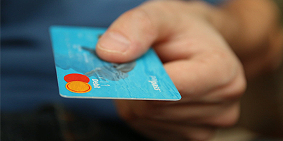 HRMS120 Personal Cardholder Information Cover photo of a hand with a credit card